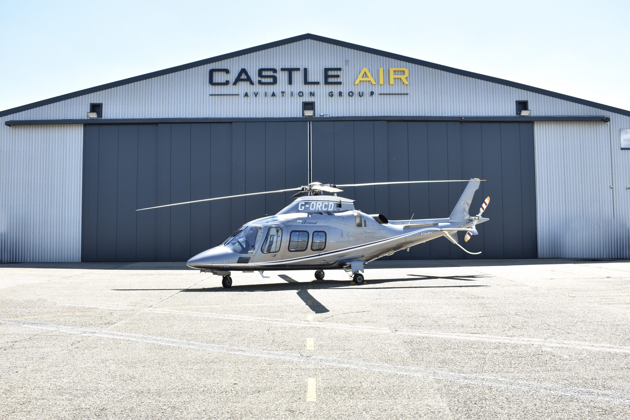 helicopter outside castle air building